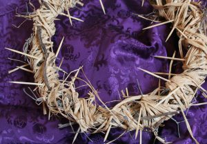 Crown of thorns on purple cloth